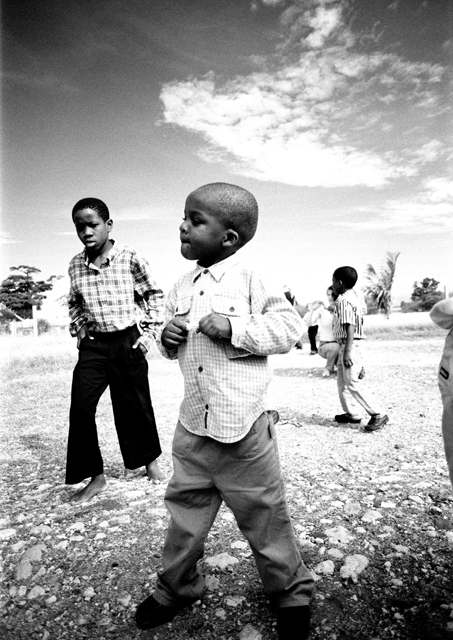 A boy at a local orphanage shows me his dance moves